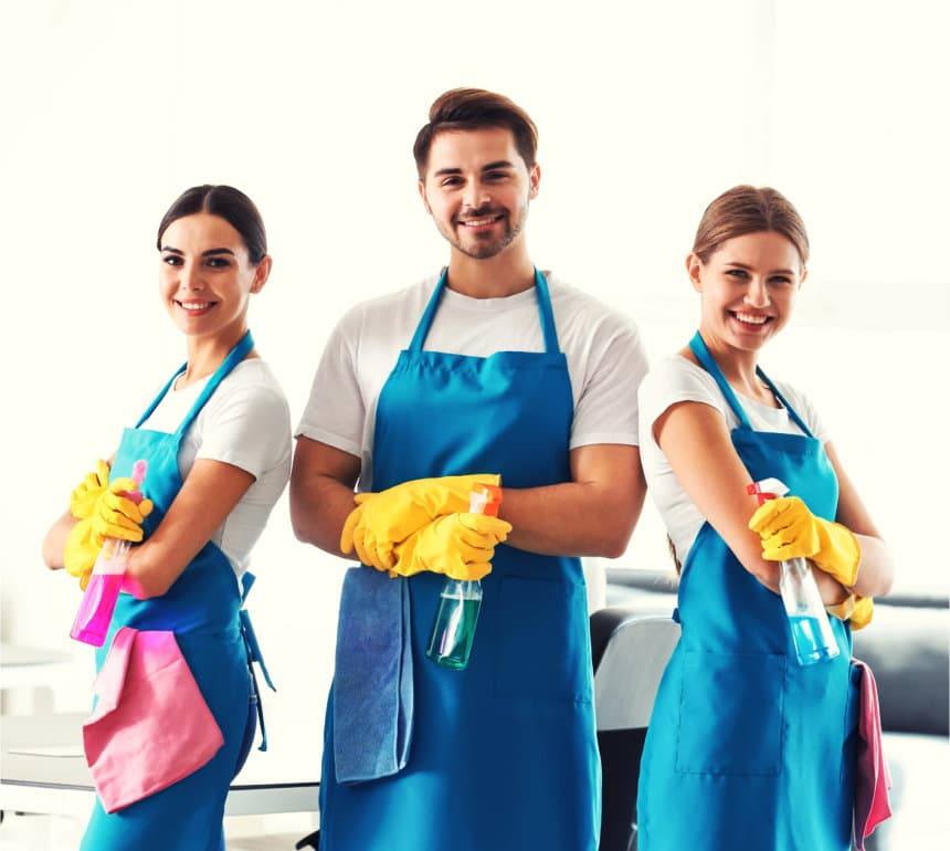two cleaners smiling