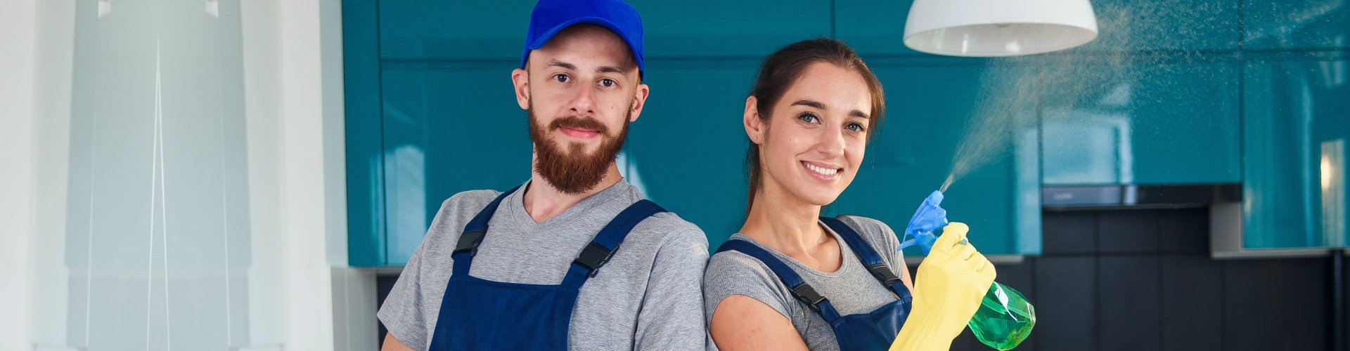 two cleaners staff smiling